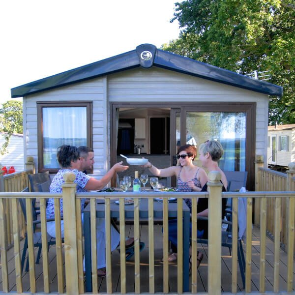 Relax on private decking at Orchards Holiday Park