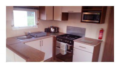 Kitchen, 10 Crosswinds, Whitecliff Bay Holiday Park